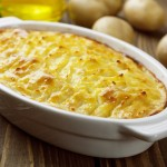 Potato casserole with meat on the wooden table